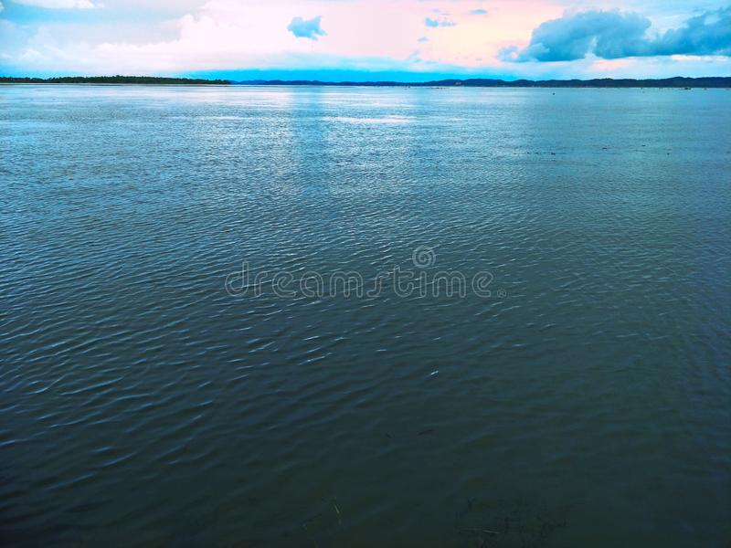 Lake in the evening. A lake is an area filled with water, localized in a basin, that is surrounded by land, apart from any river or other outlet that serves to stock images