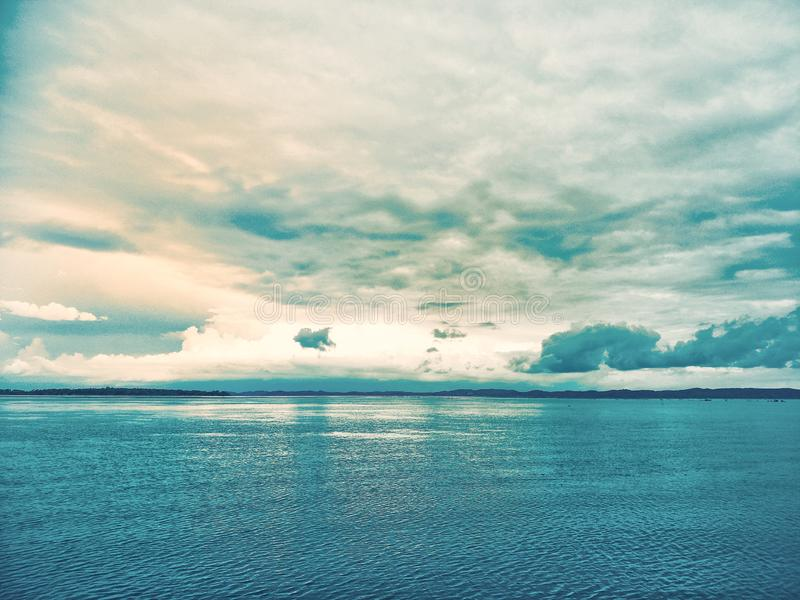 Lake in the evening. A lake is an area filled with water, localized in a basin, that is surrounded by land, apart from any river or other outlet that serves to royalty free stock photos