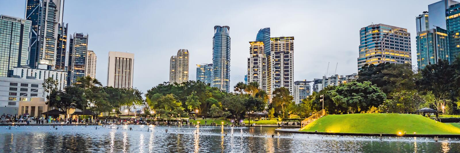 Lake in the evening, near by Twin Towers with city on background. Kuala Lumpur, Malaysia BANNER, LONG FORMAT stock photos
