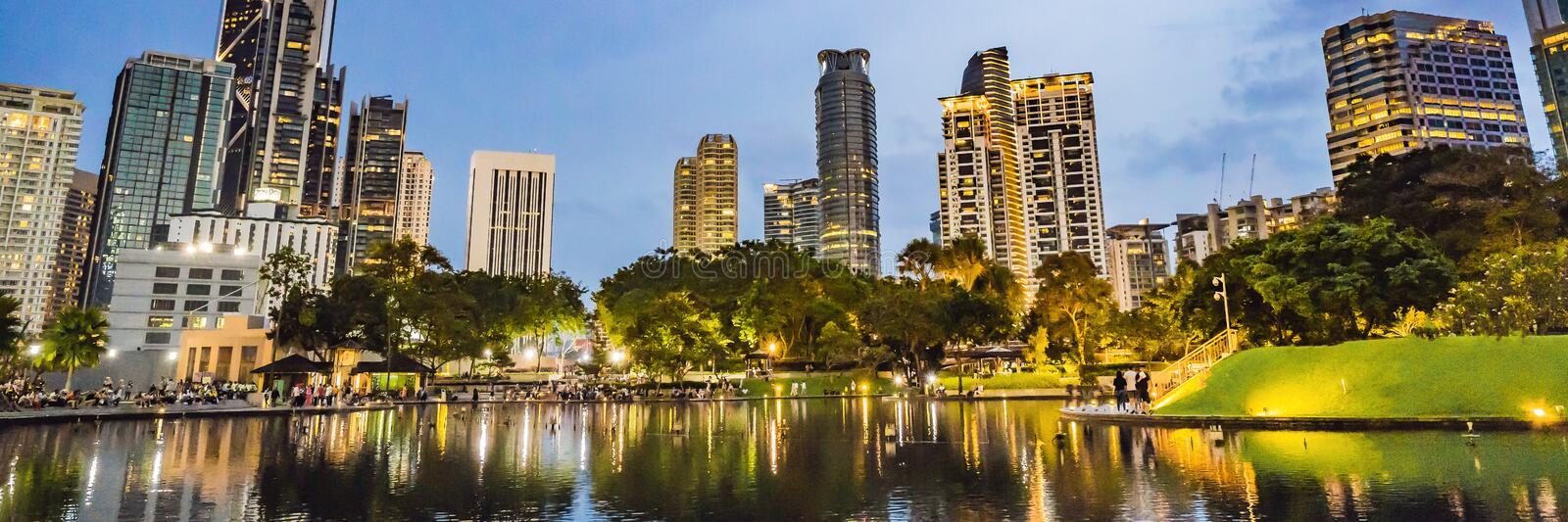 Lake in the evening, near by Twin Towers with city on background. Kuala Lumpur, Malaysia BANNER, LONG FORMAT stock photo