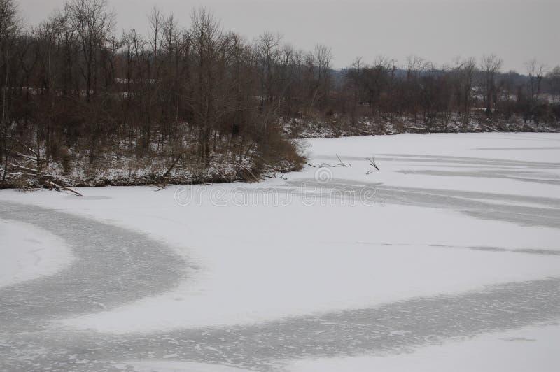 Lake frozen and still stock photo