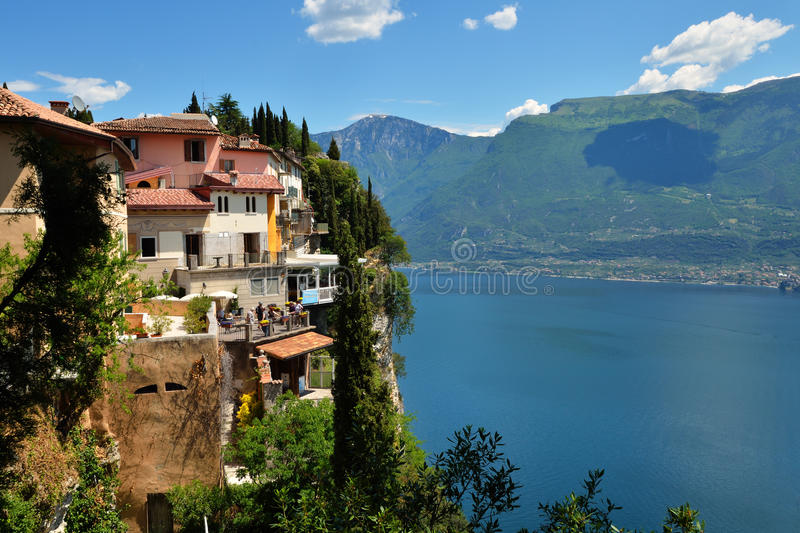 Lake Garda. Colourful houses of the small village of Pieve di Tremosine towering high above lake Garda in Trentino, Italy