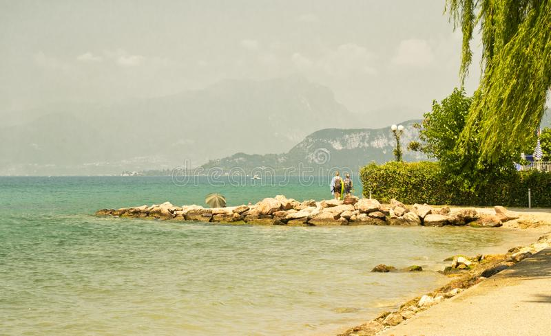 Lake of Garda, Italy. the coastline between the town of Lazise and Bardolino with Baldo Mount on the background royalty free stock images