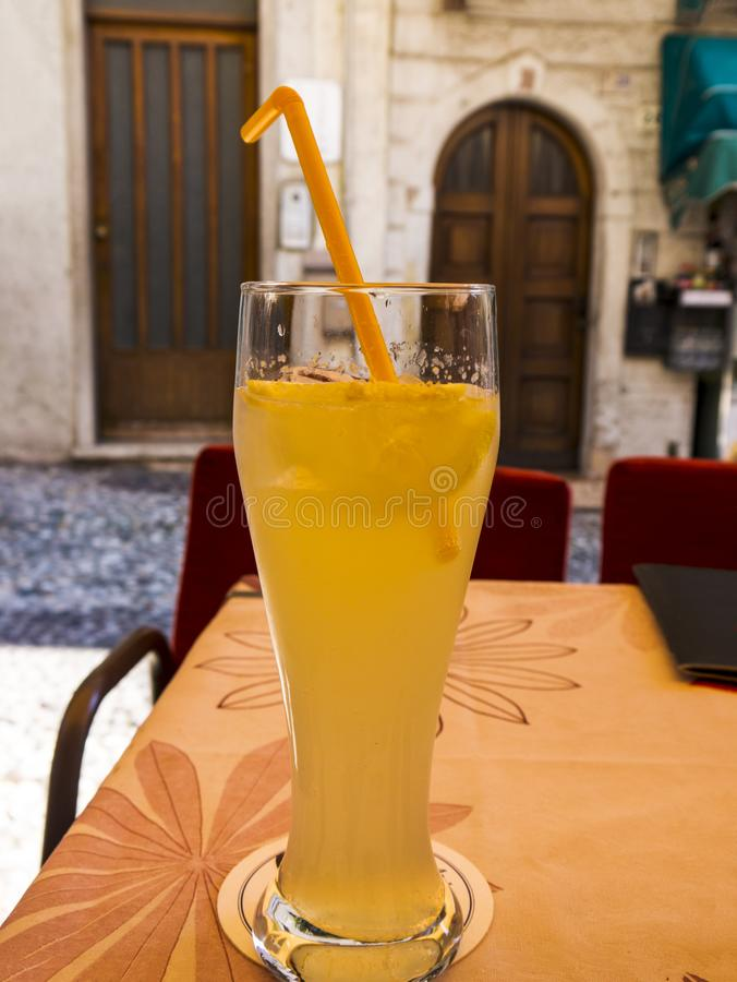 A long Cold Drink in the lovely town of Malcesine on Lake Garda where is famous castle guards the entrance to its harbour. Lake Garda is a popular European royalty free stock images