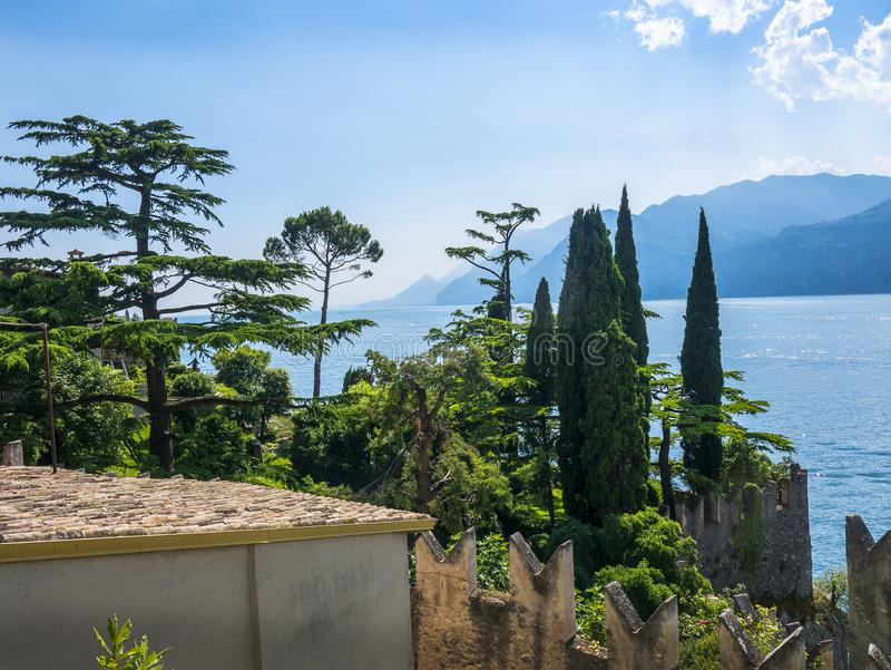 The lovely town of Malcesine on Lake Garda where is famous castle guards the entrance to its harbour.Malcesine is so s. Lake Garda is a popular European tourist royalty free stock image