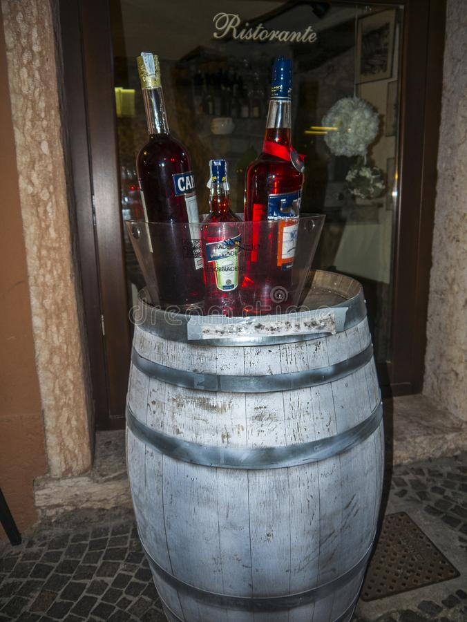 A barrel of Drinks in the lovely town of Malcesine on Lake Garda where is famous castle guards the entrance to its harbour. Lake Garda is a popular European royalty free stock photography