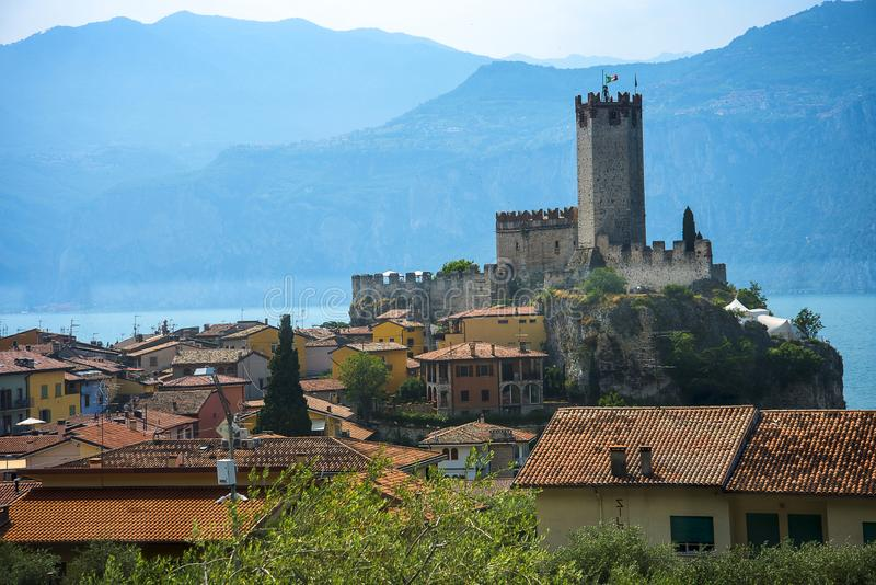 The lovely town of Malcesine on Lake Garda where is famous castle guards the entrance to its harbour. Lake Garda is a popular European tourist destination and royalty free stock images