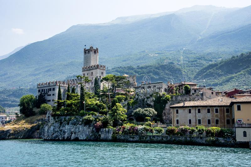 The lovely town of Malcesine on Lake Garda where is famous castle guards the entrance to its harbour. Lake Garda is a popular European tourist destination and stock photo