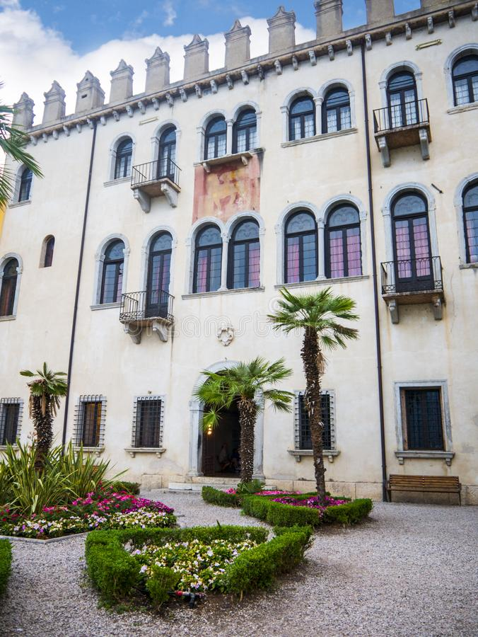 Old building in the lovely town of Malcesine on Lake Garda where is famous castle guards the entrance to its harbour. Lake Garda is a popular European tourist royalty free stock images