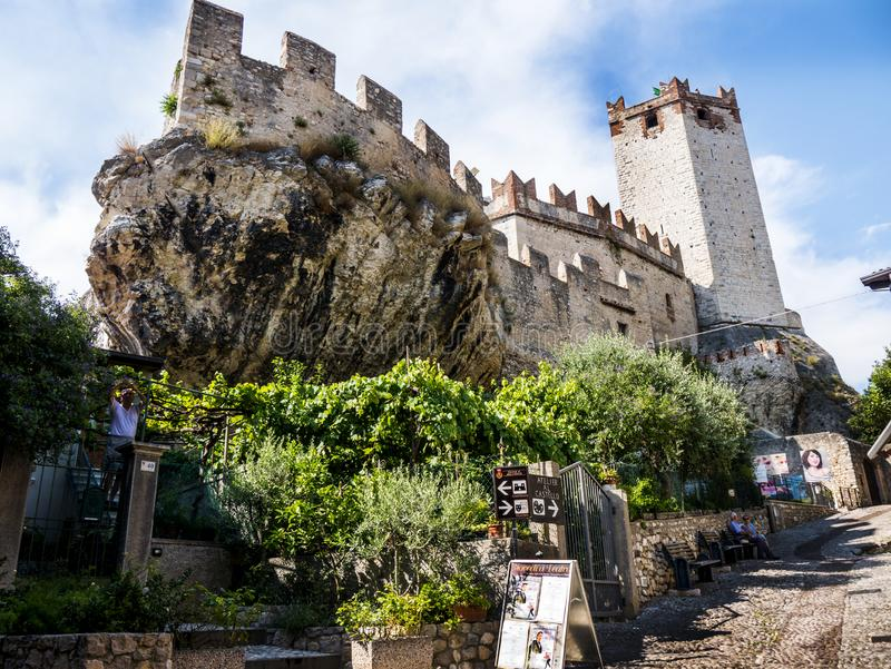 The lovely town of Malcesine on Lake Garda where is famous castle guards the entrance to its harbour.Malcesine is so s. Lake Garda is a popular European tourist royalty free stock photo