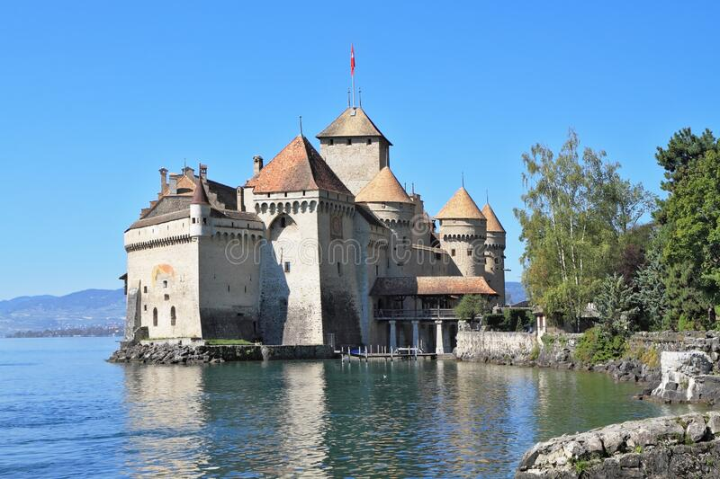 The Lake Geneva. The Castle of Chillon on Lake Geneva. A beautiful sunny day in Switzerland stock images