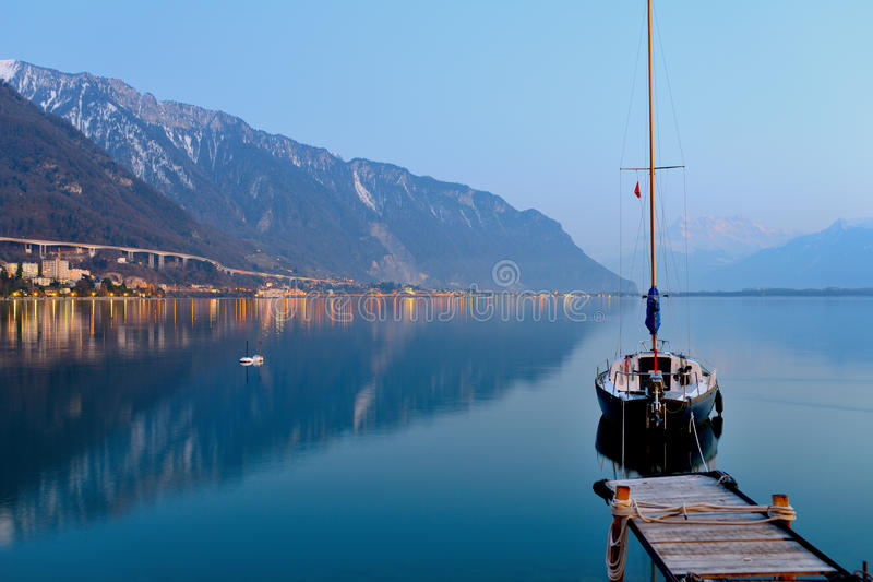 Lake Geneva at dusk royalty free stock image