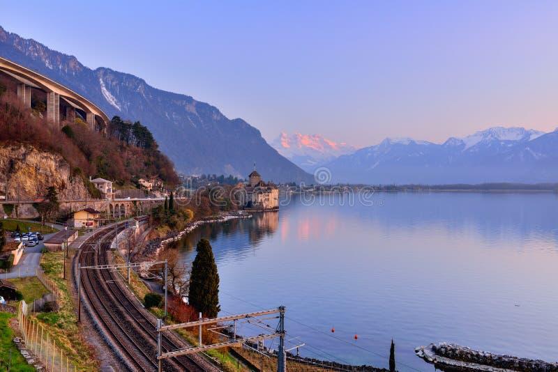 Lake Geneva at sunset with railway stock images