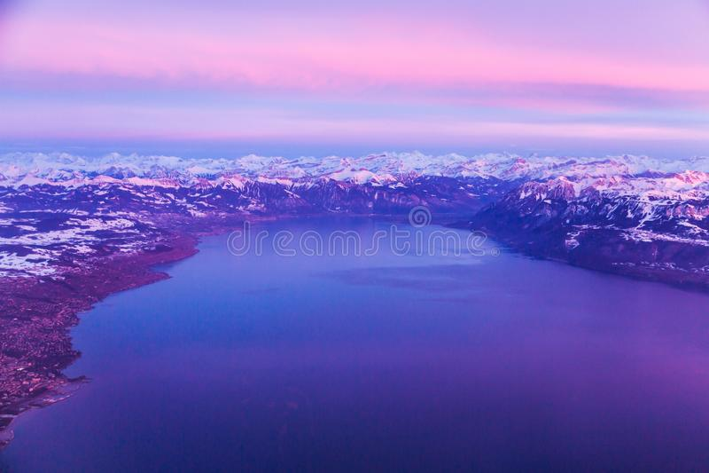 Lake Geneva and Swiss Alps taken from plane, Switzerland. Lake Geneva and Swiss Alps taken from plane during sunset, Switzerland stock images