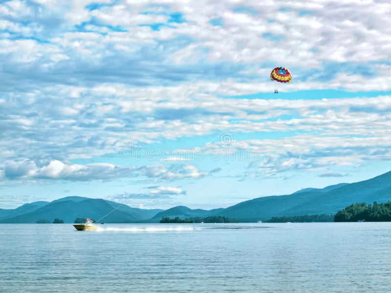 Lake George, New York. People parasailing over Lake George, New York, August, 2015 stock images