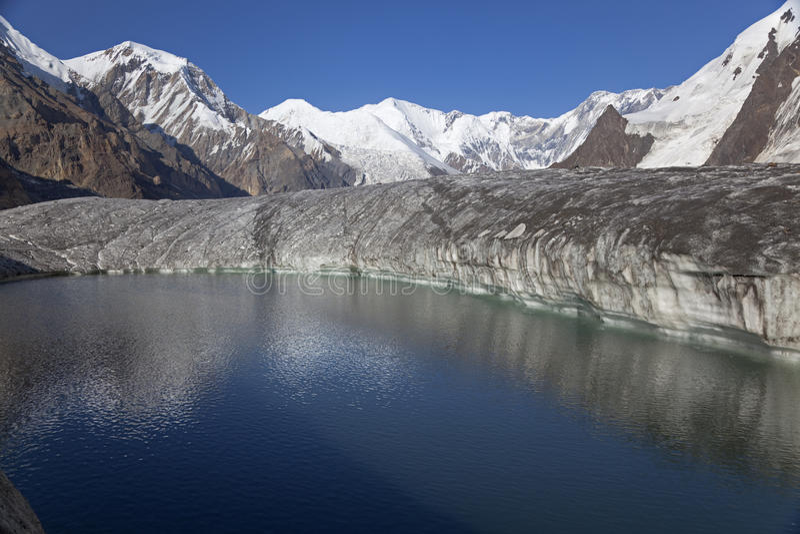 Lake on glacier, Tien Shan mountains royalty free stock image