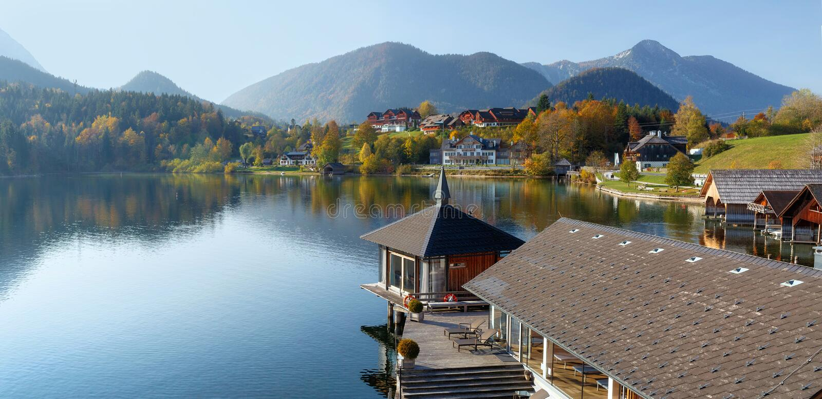 Lake Grundlsee in the fall during the sunrise. View of the Alps. Village Grundlsee, Styria, Austria. Lake Grundlsee in the fall during the sunrise. View of the royalty free stock photography