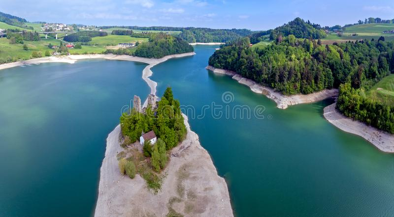 Lake Gruyere in the Canton of Fribourg, Switzerland. The remains of the castle of Pont or Pont-en-Ogoz and a chapel are located on the Ile d`Ogoz, one of the royalty free stock photography