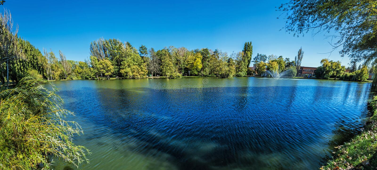 Lake Hangocka, city park, Nitra, Slovakia. Seasonal natural scene. Panoramic photo royalty free stock photos