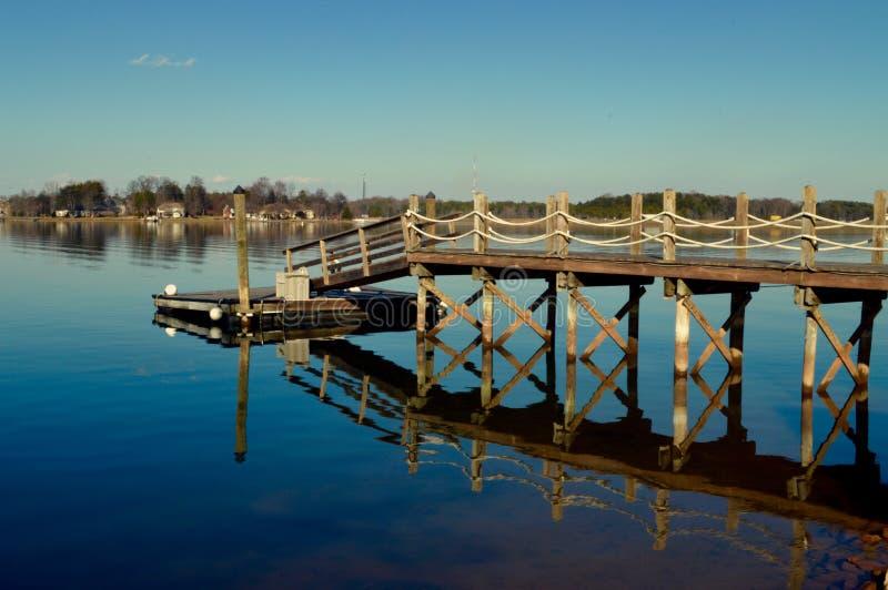 Lake house dock stock photo