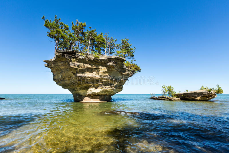 Lake Huron`s Turnip Rock, near Port Austin Michigan. Turnip Rock on Lake Huron in Port Austin Michigan. An underwater view shows rocks under the clear surface of royalty free stock image