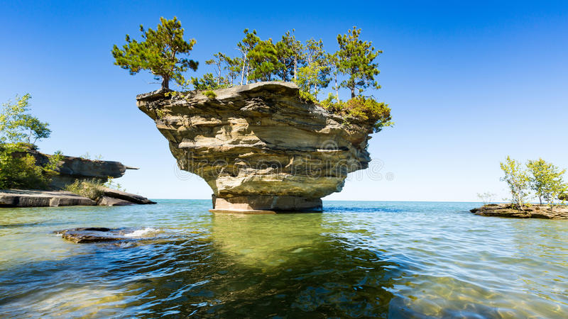Lake Huron`s Turnip Rock, near Port Austin Michigan. Turnip Rock on Lake Huron in Port Austin Michigan. An underwater view shows rocks under the clear surface of stock images