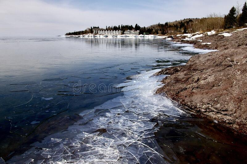 Lake Ice on Lake Superior. Broken ice line the shore of Lake Superior as the lake awaits spring break-up stock photo