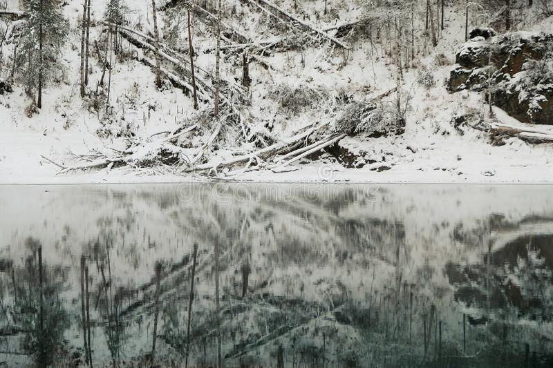 Lake with ice reflecting snow covered mountains. Blue Lake in the Altai Mountains.  royalty free stock photos