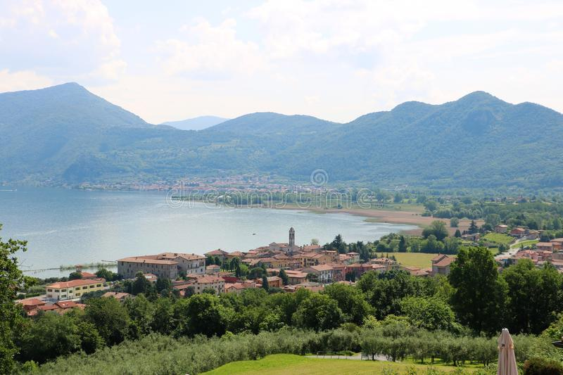 Lake Iseo, Italy. View on the southern end of lake Iseo, the fourth largest lake in Lombardy, Italy. There are several medieval towns around the lake, the stock images