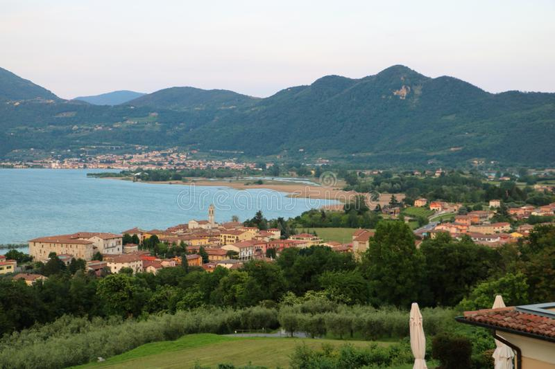 Lake Iseo, Italy. View on the southern end of lake Iseo, the fourth largest lake in Lombardy, Italy. There are several medieval towns around the lake, the royalty free stock photo