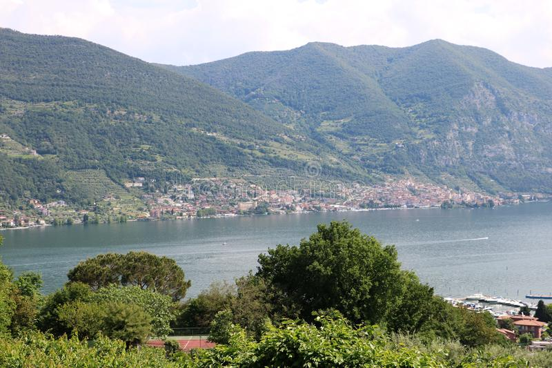 Lake Iseo, Italy. View on the southern end of lake Iseo, the fourth largest lake in Lombardy, Italy. There are several medieval towns around the lake, the royalty free stock photography