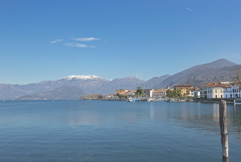 Lake Iseo in Lombardy, Italy. Spring landscape with Lake Iseo, Lombardy, Italy with mountains on the background and town Iseo seen on the right stock photo