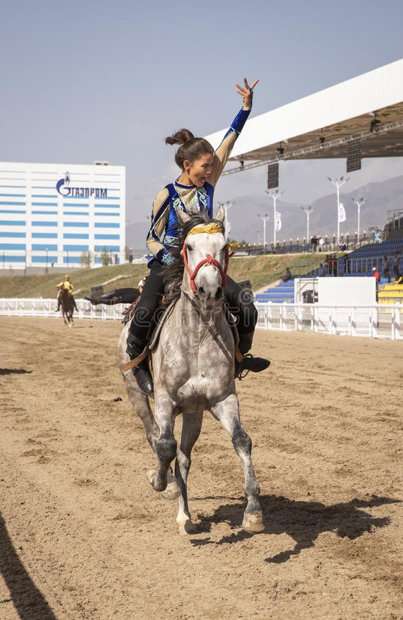 Young woman riding a horse stock image
