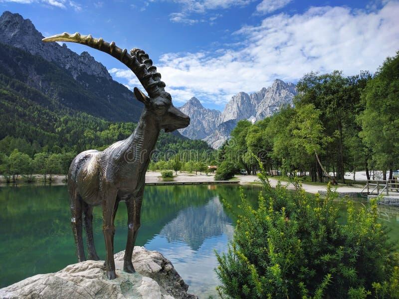 Lake Jasna and mountain goat statue closeup in Kranjska Gora, Slovenia stock photos