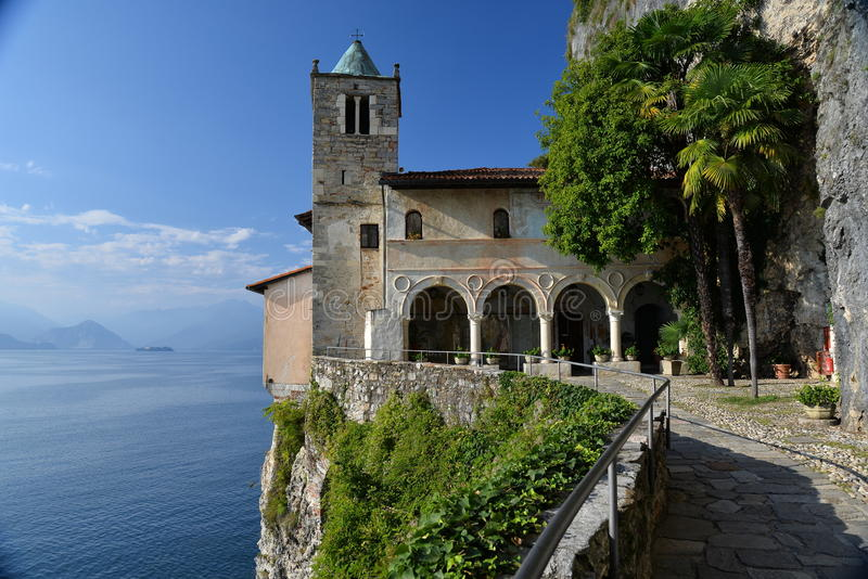 Lake - lago - Maggiore, Italy. Santa Caterina del Sasso monastery. The monastery of Santa Caterina del Sasso built on a cliff flank, hanging above the waters of royalty free stock photos