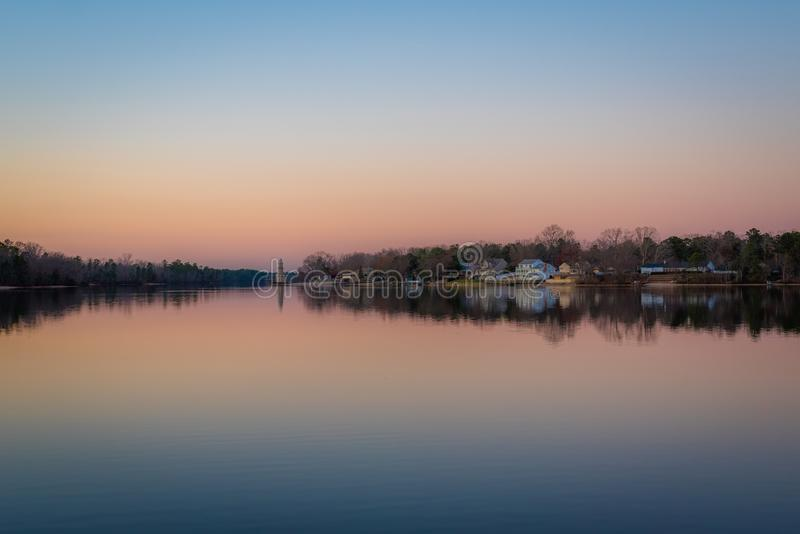 Lake Lenape at sunset, in Mays Landing, New Jersey.  royalty free stock image
