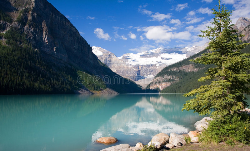 Lake Louise. In the Canadian Rockies in the morning with the reflections of Mount Victoria and its glacier on the water royalty free stock images