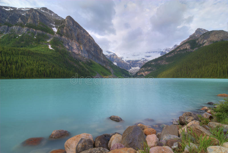 Lake Louise. The incredible turquoise blue water of Lake Louise in Banff National Park in Alberta Canada. The amazing color is natural and is caused by light royalty free stock images