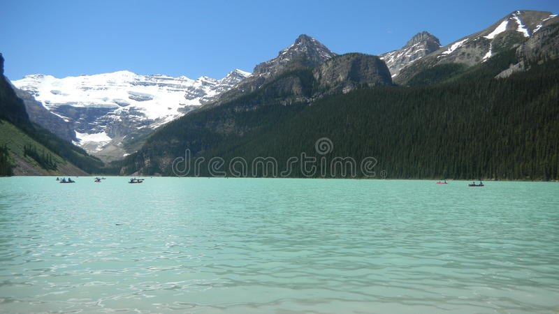 Lake Louise, Alberta Canada. The famous Lake Louise in the Canadian Rockies with snow capped mountains royalty free stock images