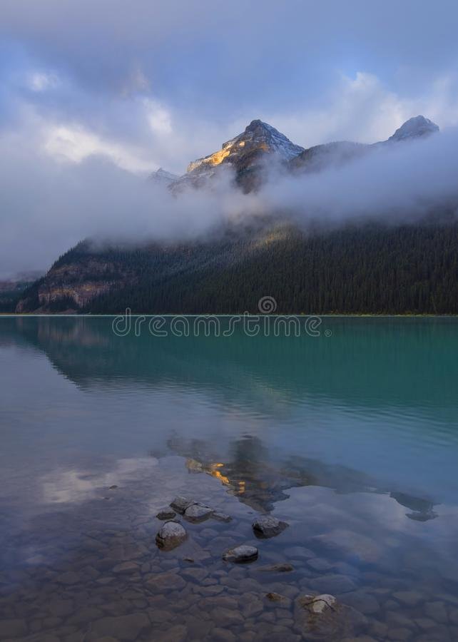 Lake Louise in Foggy Morning. Lake Louise is a beautiful lake, known for its turquoise, glacier-fed water royalty free stock photo