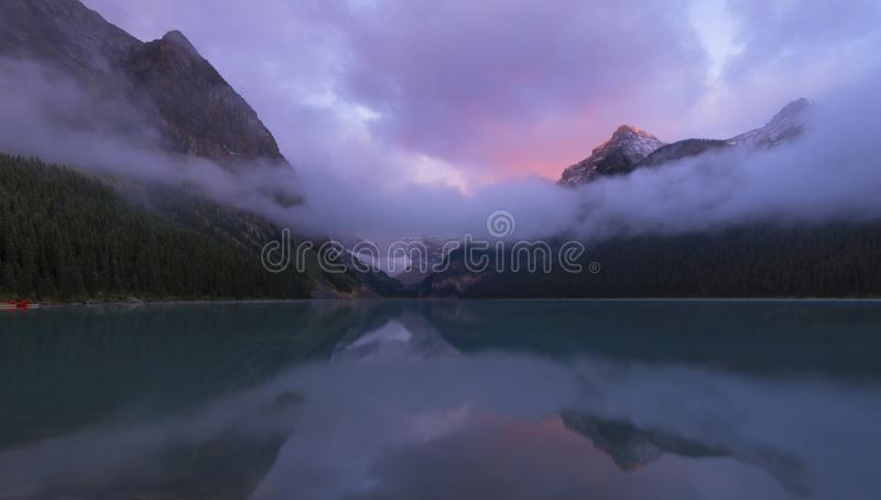 Lake Louise in Foggy Morning. Lake Louise is a beautiful lake, known for its turquoise, glacier-fed water stock photo