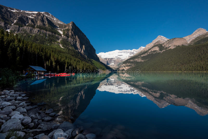 Lake Louise Boat House. With mountain reflection royalty free stock image