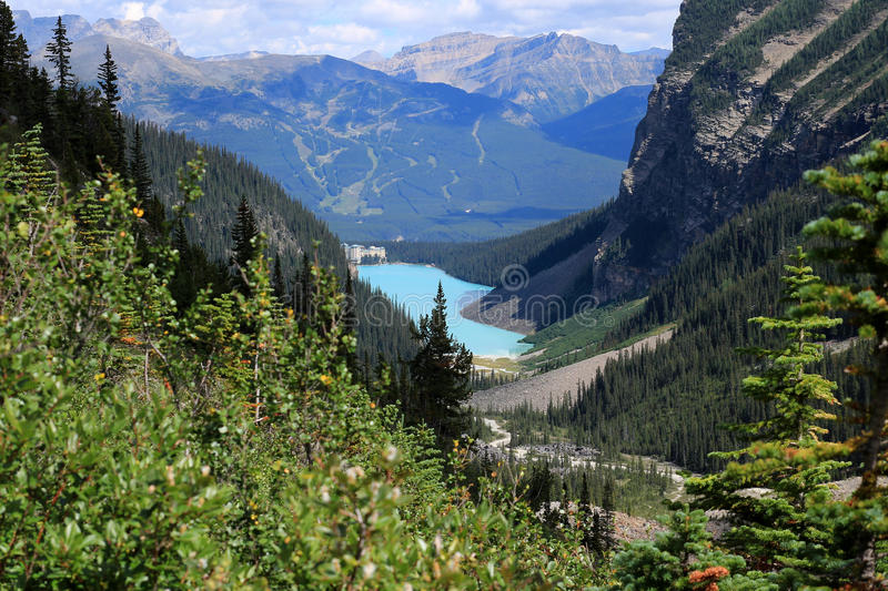 Lake Louise and the Chateau Lake Louise seen from the Plain of the Six Glaciers hiking trail. Banff National Park, Alberta, Canada royalty free stock photos