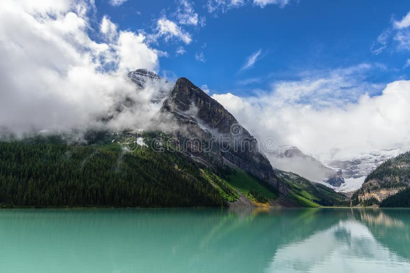 Lake louise and cloudy mountains in Banff national park. Canadian rockies stock image