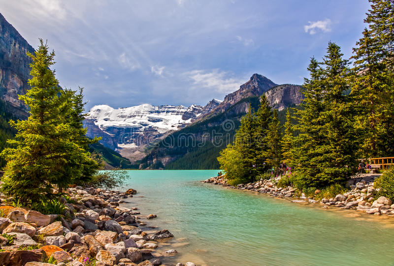 Lake Louise. Louise creek - runs out of lake louise in the rockies view of glacier in distance stock image