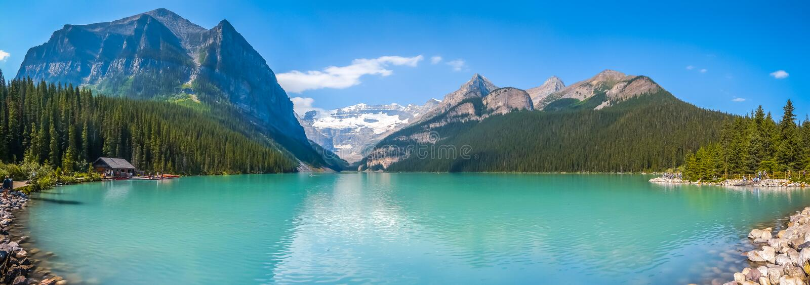 Lake Louise mountain lake in Banff National Park, Alberta, Canada. Beautiful panoramic view of Lake Louise mountain lake in Banff National Park on a sunny summer stock photography
