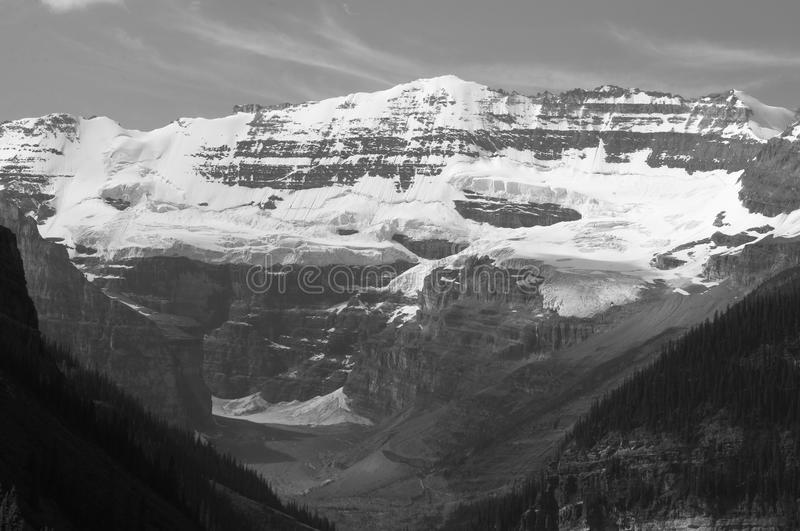 Lake Louise Mountains in Black and White. Mountains that overlook Lake Louise in Alberta Canada royalty free stock image