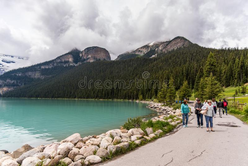 Lake Louise pristine environment is a must see for tourists. royalty free stock image