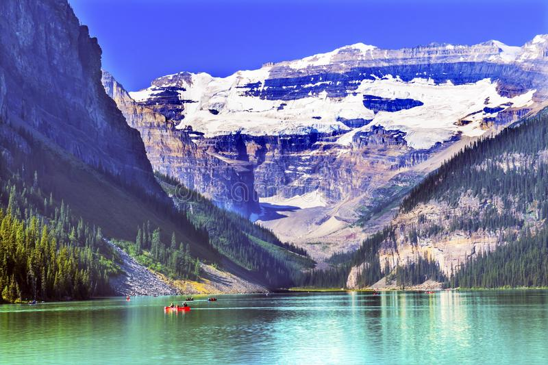 Lake Louise Canoes Snow Mountains Banff National Park Alberta Ca. Lake Louise Red Canoes Leroy Glaciers Reflection Snow Mountains Banff National Park Alberta royalty free stock photo