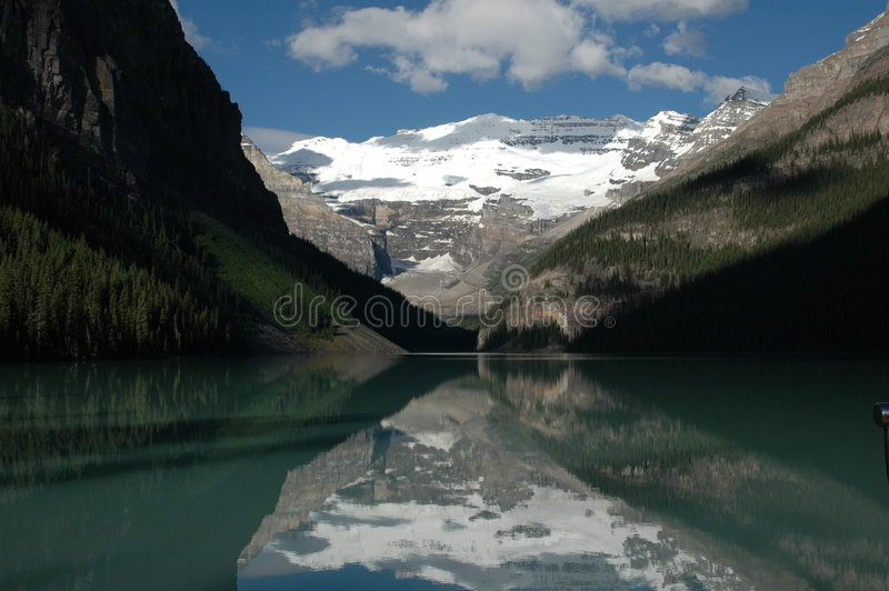 Lake Louise Reflection. Mountains refelct in famous Lake Louise, Banff National Park, Canada royalty free stock photography